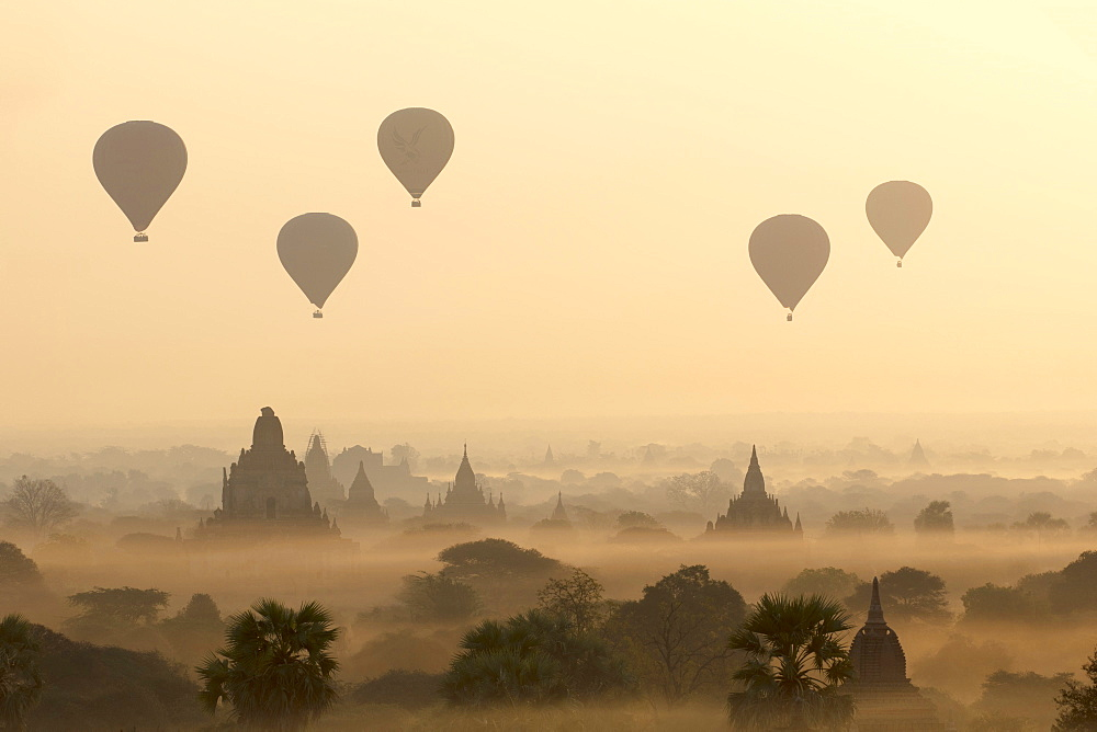 Hot air ballons fly over ancient temples at dawn in Bagan (Pagan), Myanmar (Burma), Asia