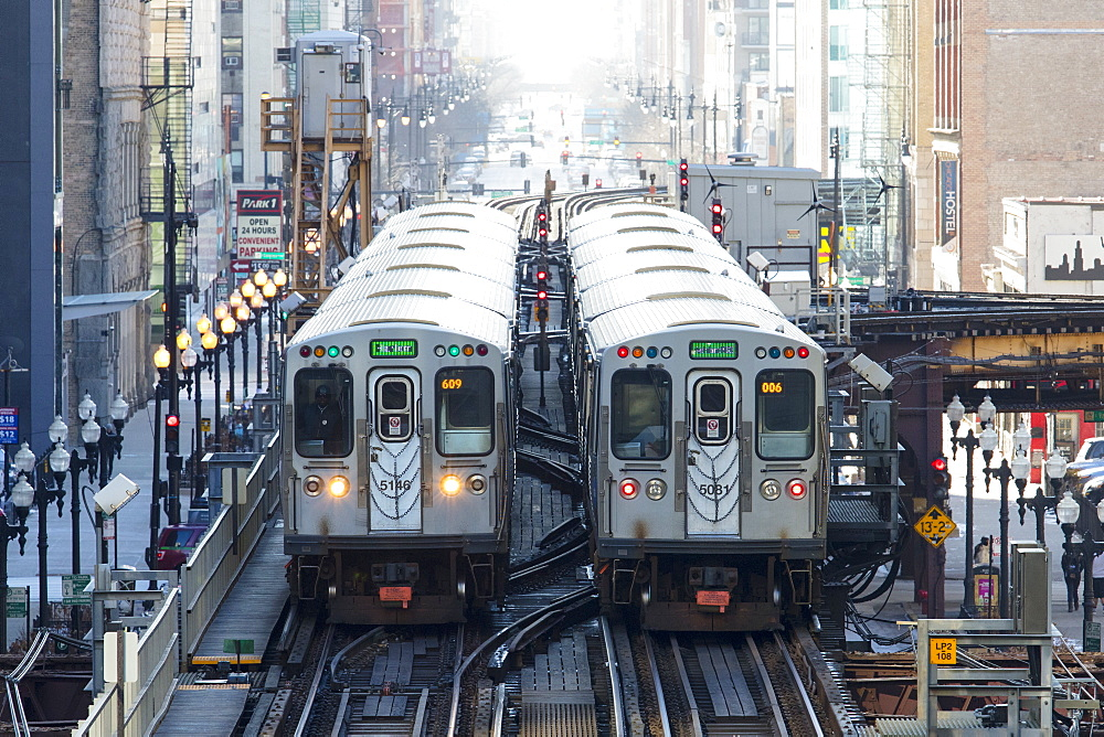 Two Chicago CTA L trains near Adams and Wabash station in The Loop, Chicago, Illinois, United States of America, North America