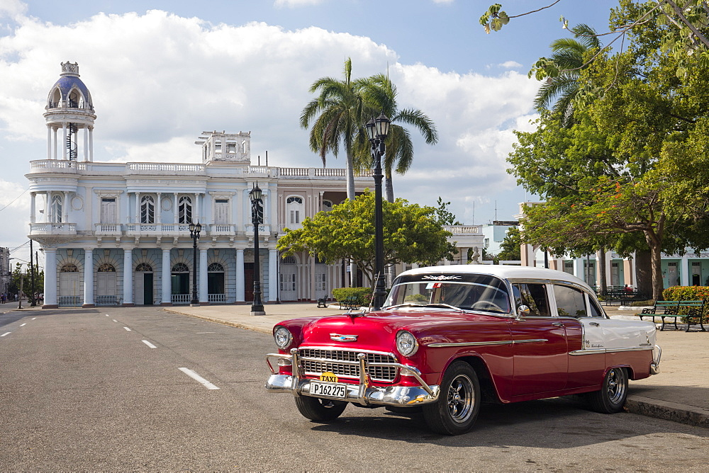 Red Chevrolet Bel Air parked in Cienfuegos town square, UNESCO World Heritage Site, Cuba, West Indies, Caribbean, Central America