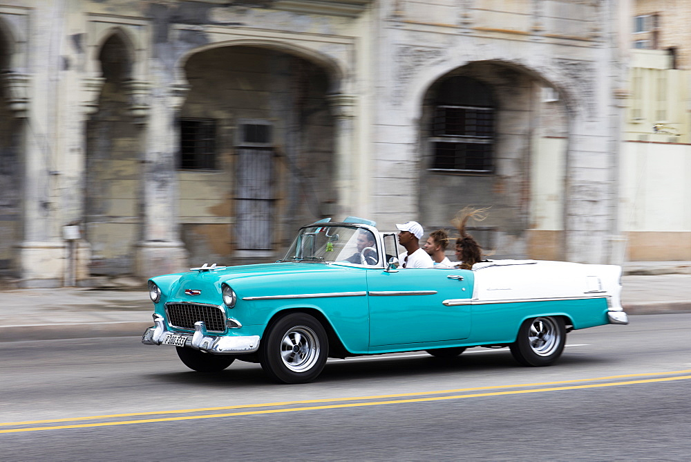 Turquoise vintage convertible American car driving along the Malecon in Havana, Cuba, West Indies, Caribbean, Central America - 1284-93