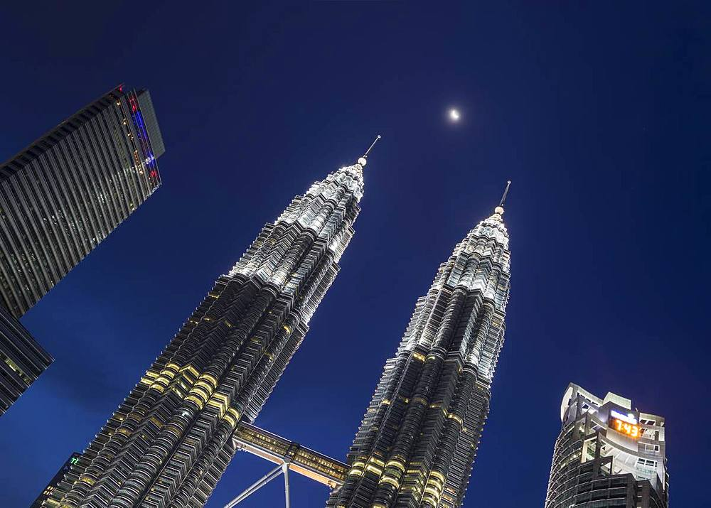 Petronas Twin Towers with the moon showing in between, Kuala Lumpur, Malaysia, Southeast Asia, Asia