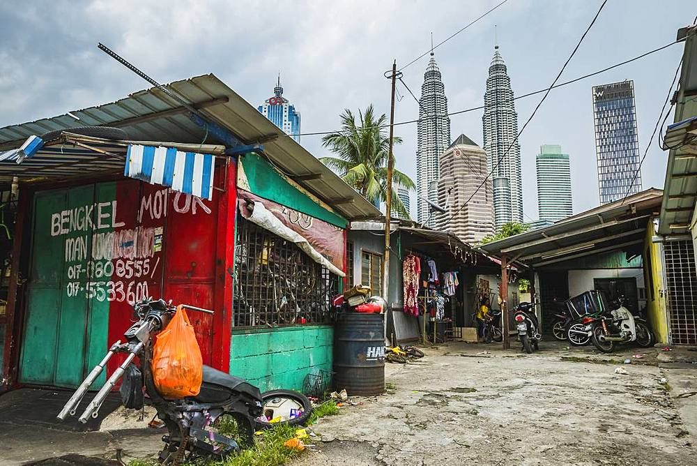 Side street in Kampung Baru with the Petronas Twin Towers in the background, Kuala Lumpur, Malaysia, Southeast Asia, Asia