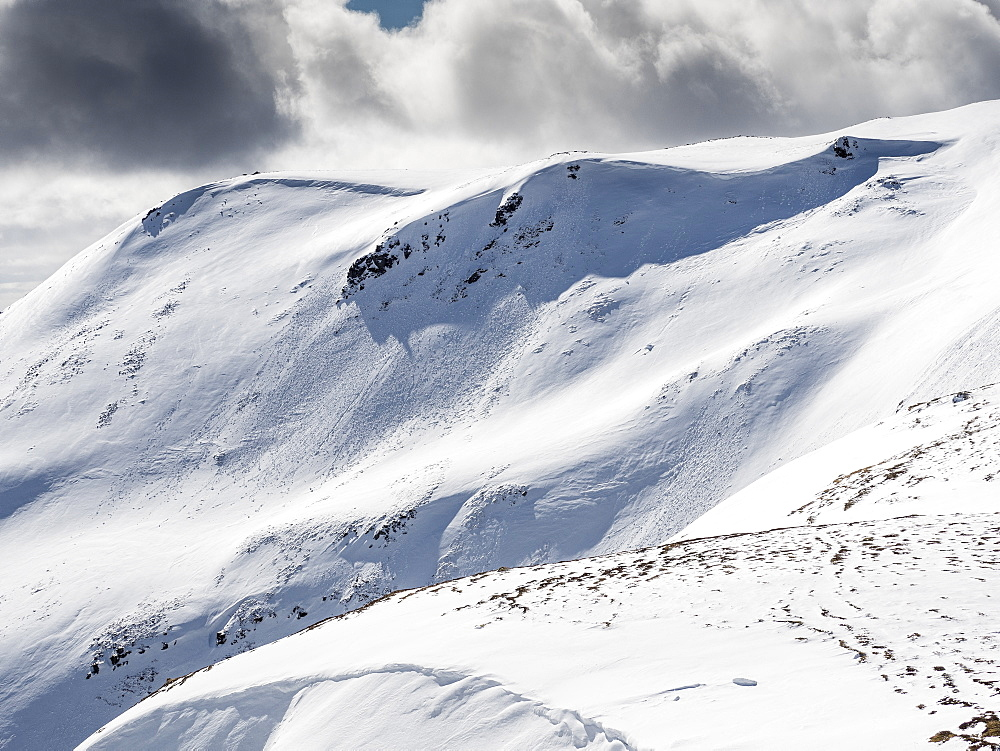Fresh avalanche debris on Carn nan Sac, 920m, on the hills above Glenshee ski centre in the Cairngorm National Park, Scotland, United Kingdom, Europe