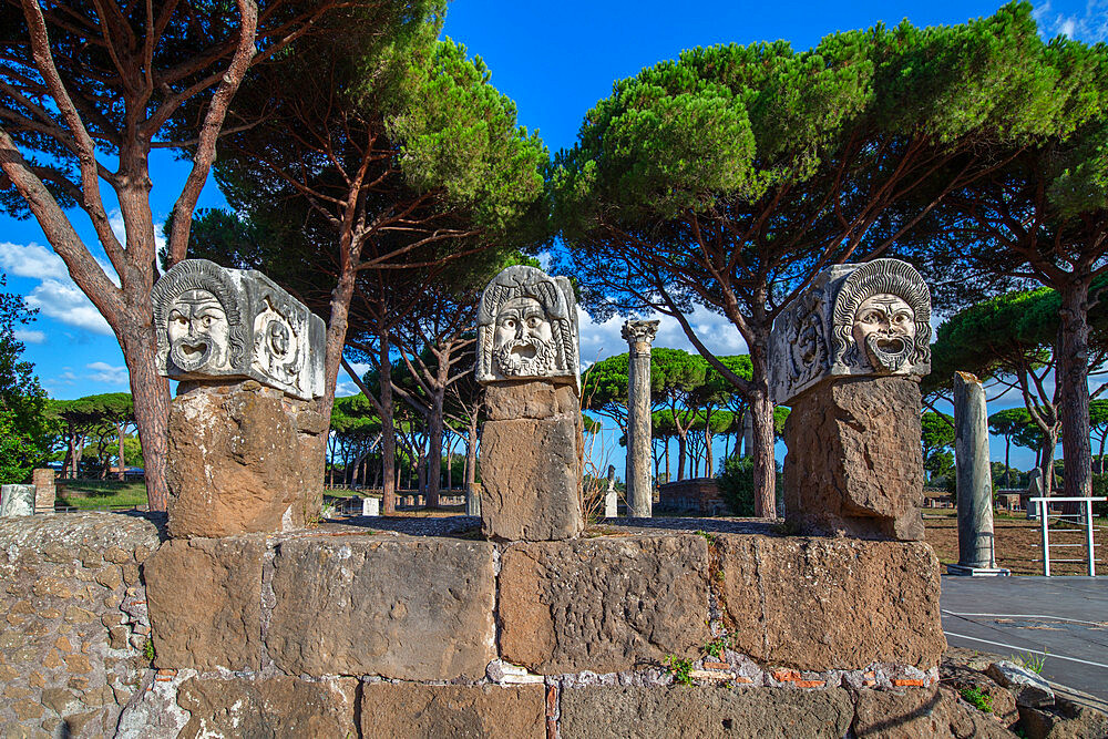 surroundings of the tether, three theatrical masks, , Ostia antica, Roma, Lazio, Italy.