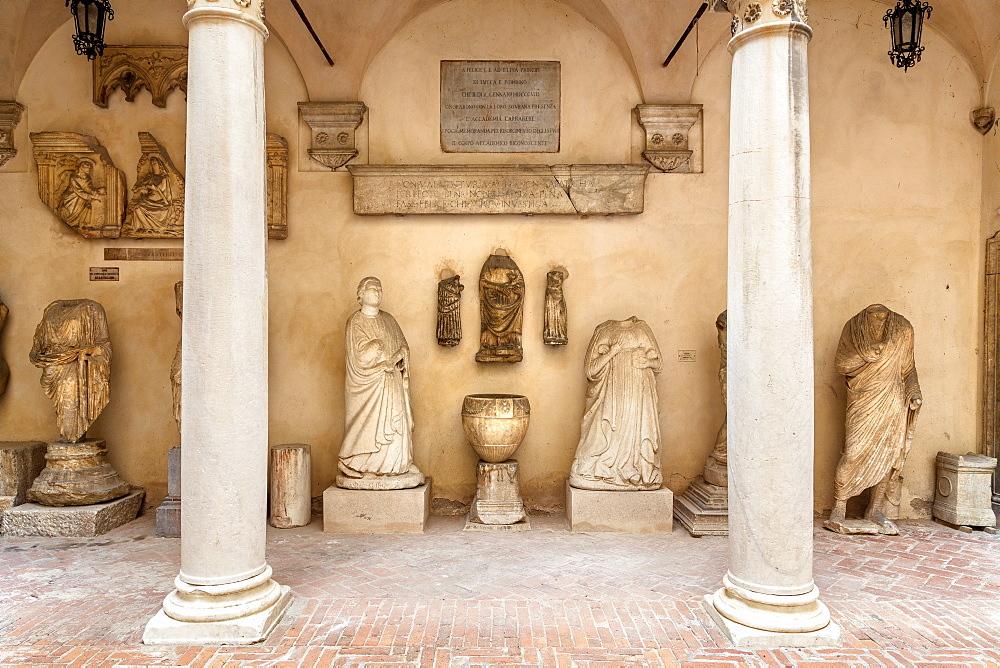 Carrara Academy of Fine Arts,External courtyard with Roman statuary found in the Roman city of Luni, Carrara,Tuscany,Italy