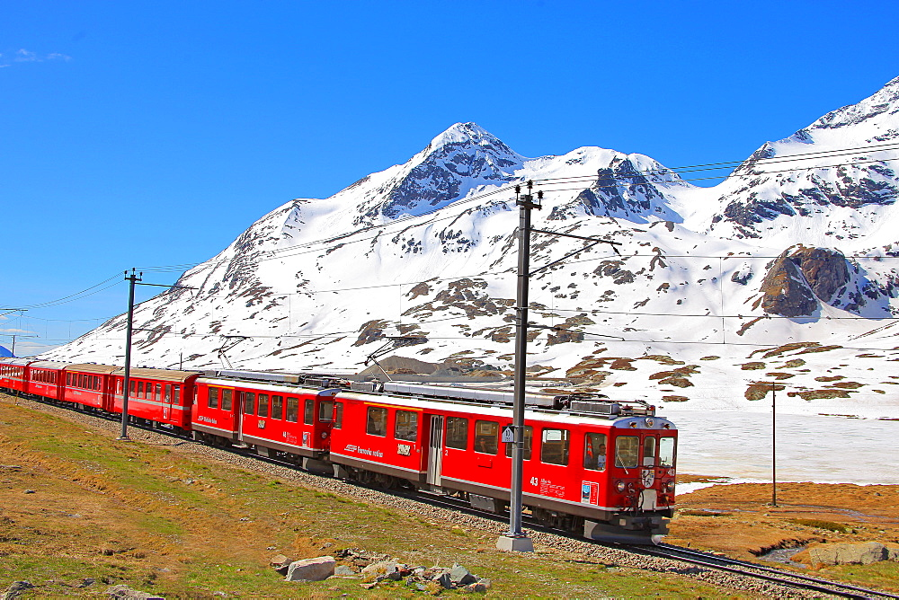The Bernina express near the Black Lake, Canton of Graubunden (Grigioni), Switzerland, Europe