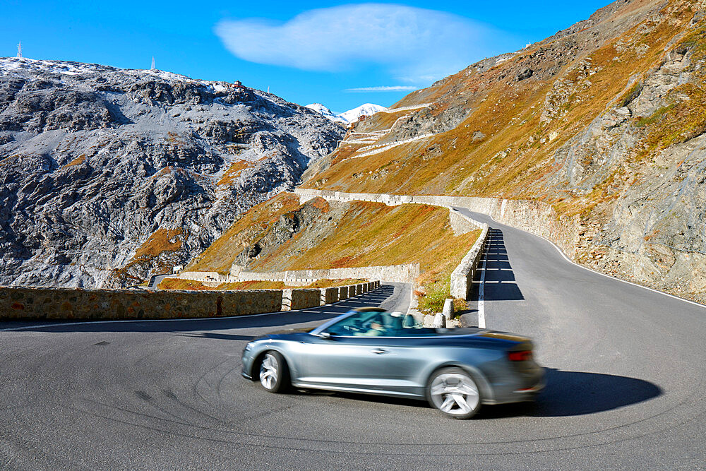 Convertible car driving downwards Pass road Stilfser Joch
