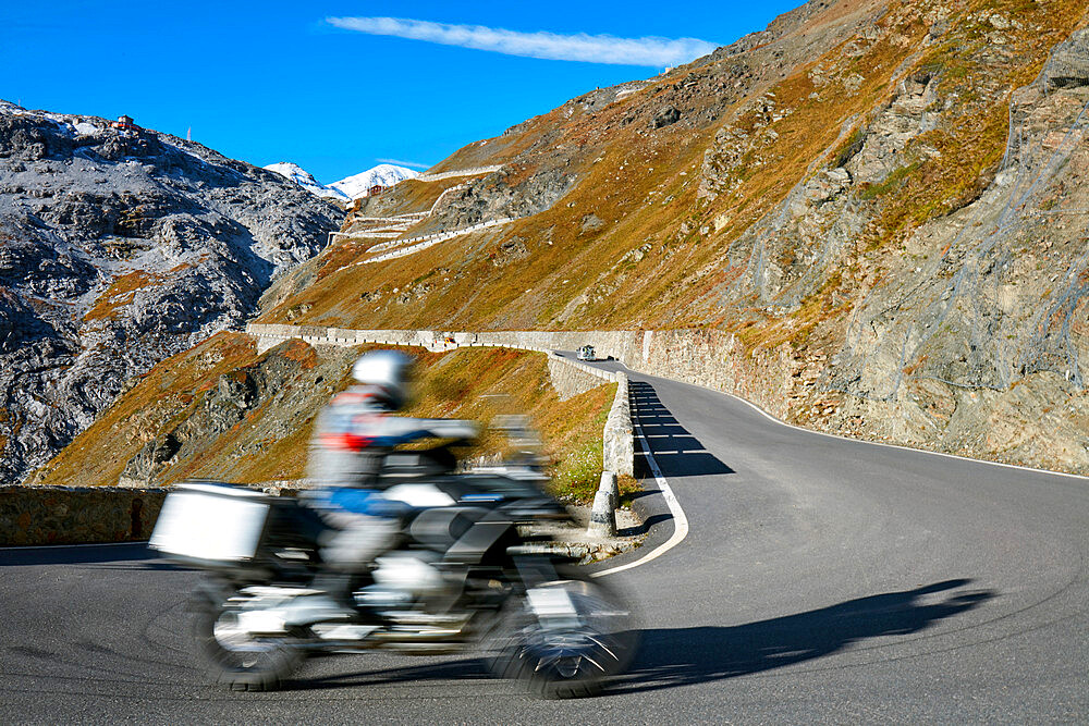 Motorbike driving up Pass road Stilfser Joch. Motion blur