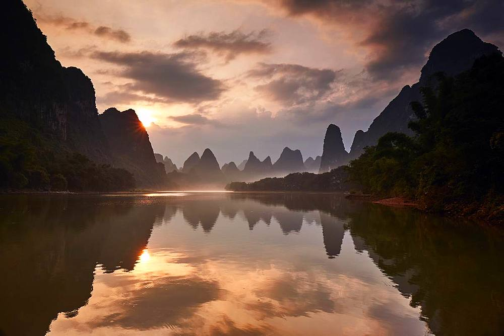 Sunrise reflected in the Li River, Guilin, China, Asia