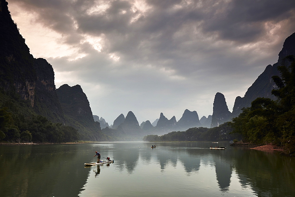 Real fishermen on Li River at sunrise, Guilin, China, Asia