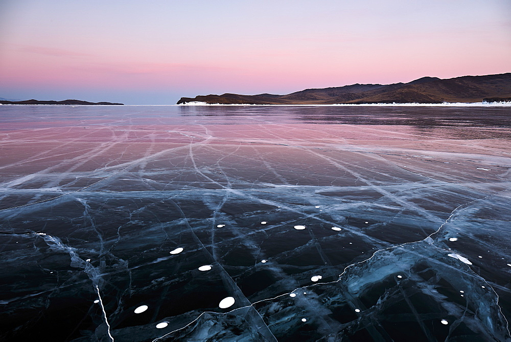 Lake Baikal in winter ice at sunset - 1294-83