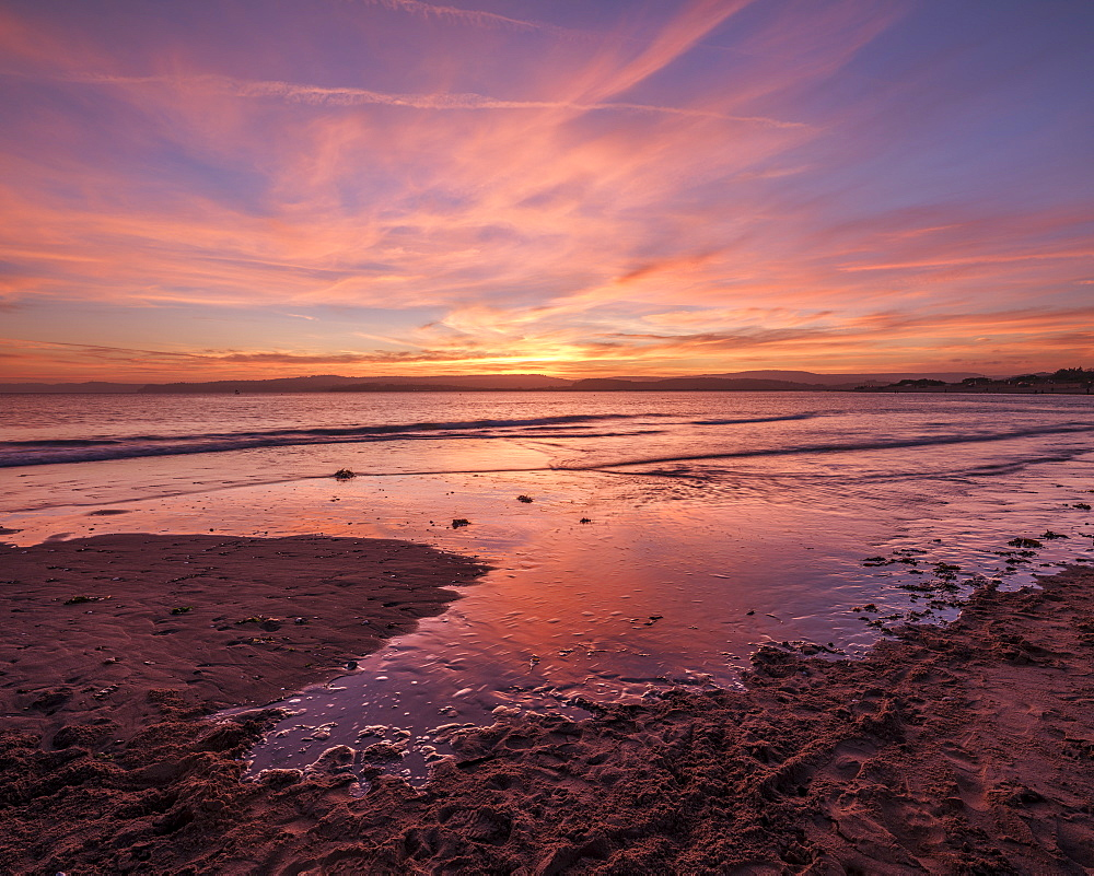 Really strong afterglow and interesting wispy clouds, reflected in the sea at Exmouth, Devon, England, United Kingdom, Europe - 1295-104