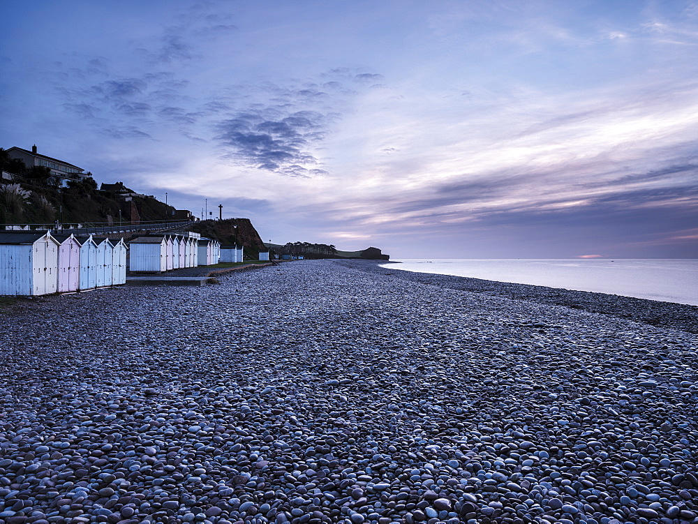 Twilight scene with beach huts and dew laden glistening pebbles on the beach at Budleigh Salterton, Devon, England, United Kingdom, Europe - 1295-109
