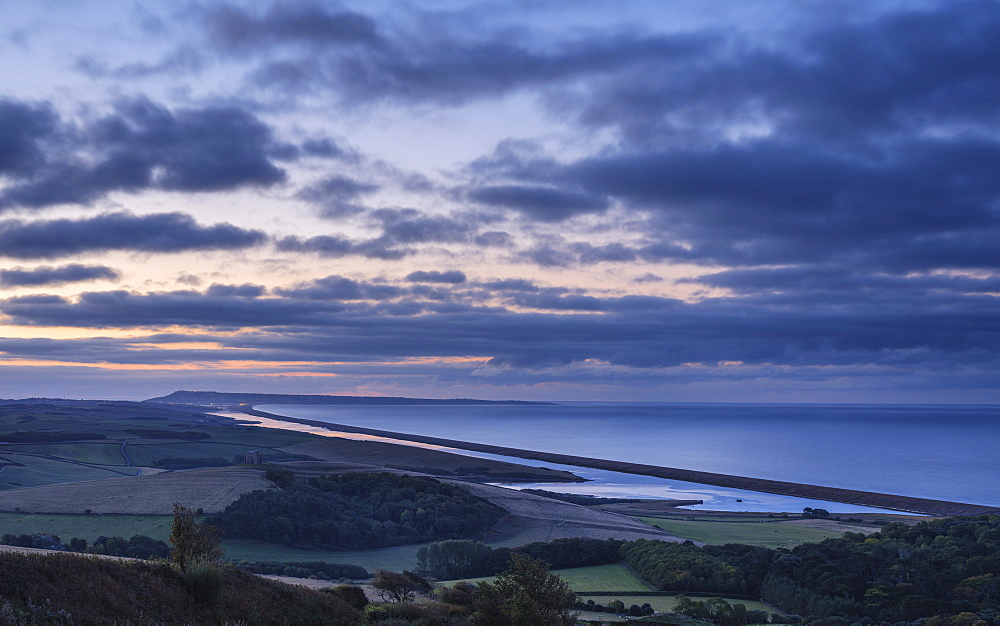 Portland, the sweep of Chesil Beach, the inland lagoon the Fleet seen from the hill at Abbotsbury, near Weymouth, Dorset, England, United Kingdom, Europe - 1295-117