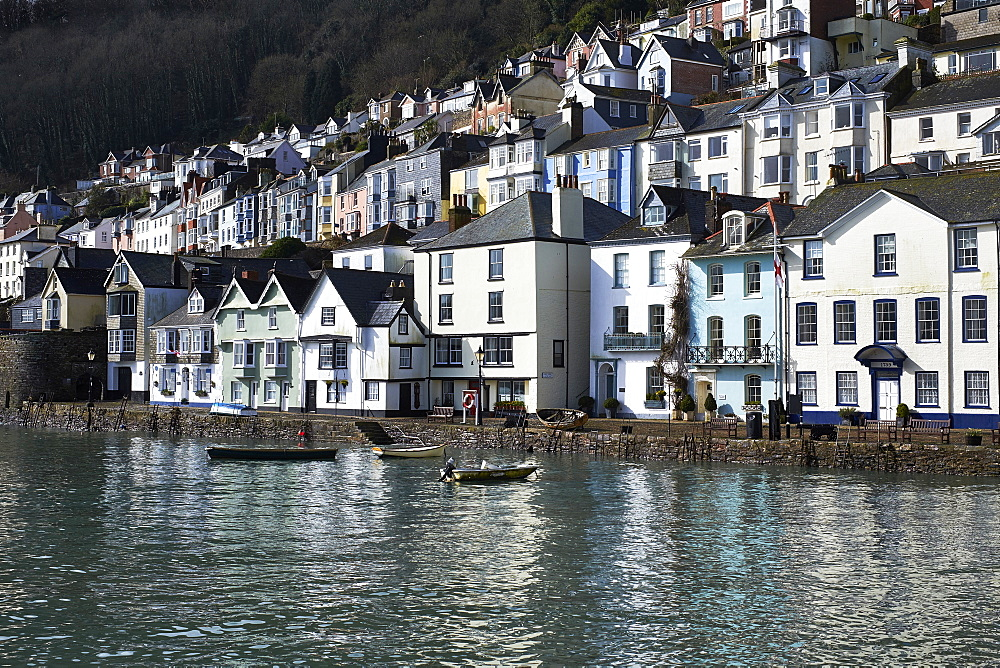 The colourful buildings & their reflections in morning sunshine at Dartmouth, Devon, UK.