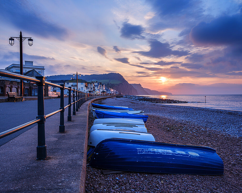 Sunrise looking along the beach at the picturesque seaside town of Sidmouth, Devon, UK - 1295-204