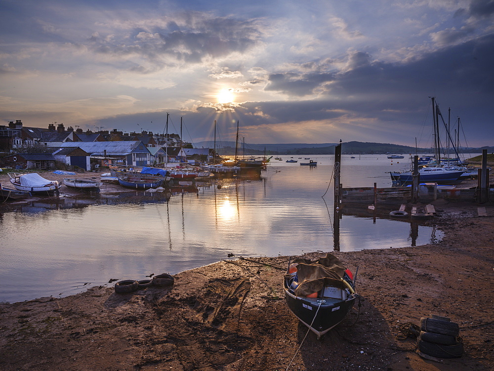 Sunset with boats on the Exe shoreline at the back of Camperdown Terrace, Exmouth, Devon, England, United Kingdom, Europe