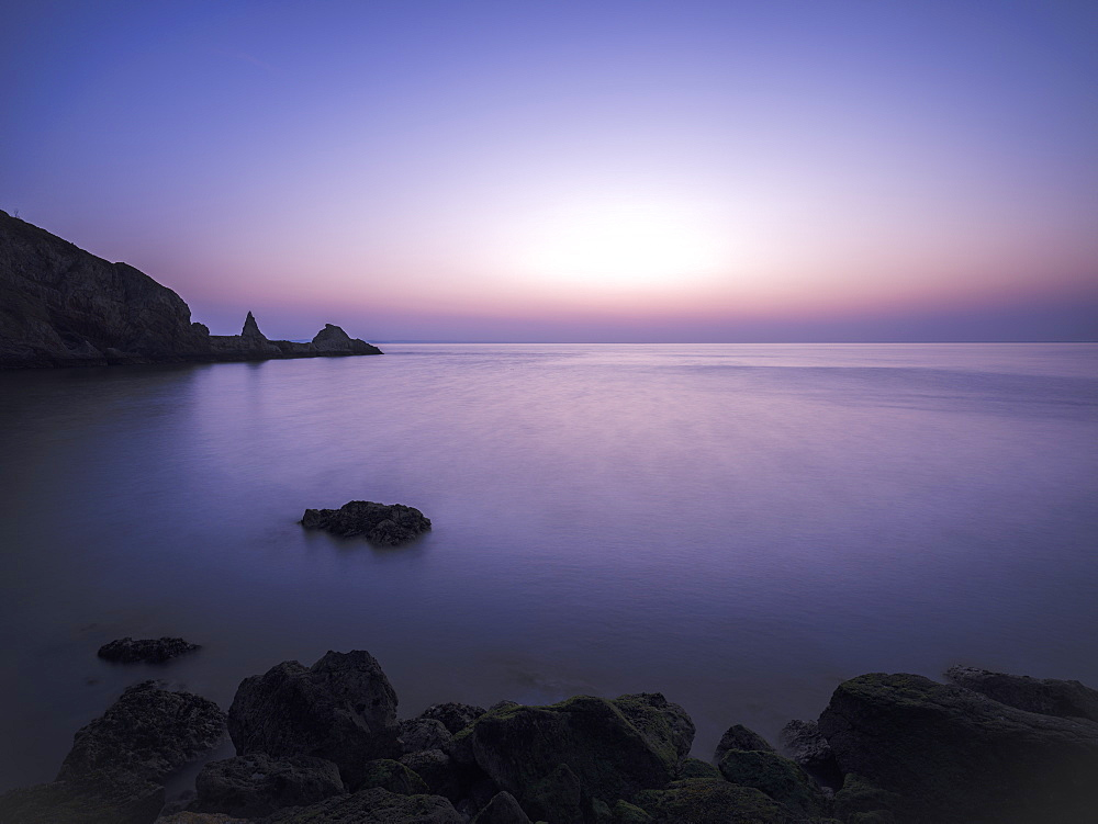 Cool dawn twilight looking out into Torbay, Anstey's Cove, Torquay, Devon, England, United Kingdom, Europe
