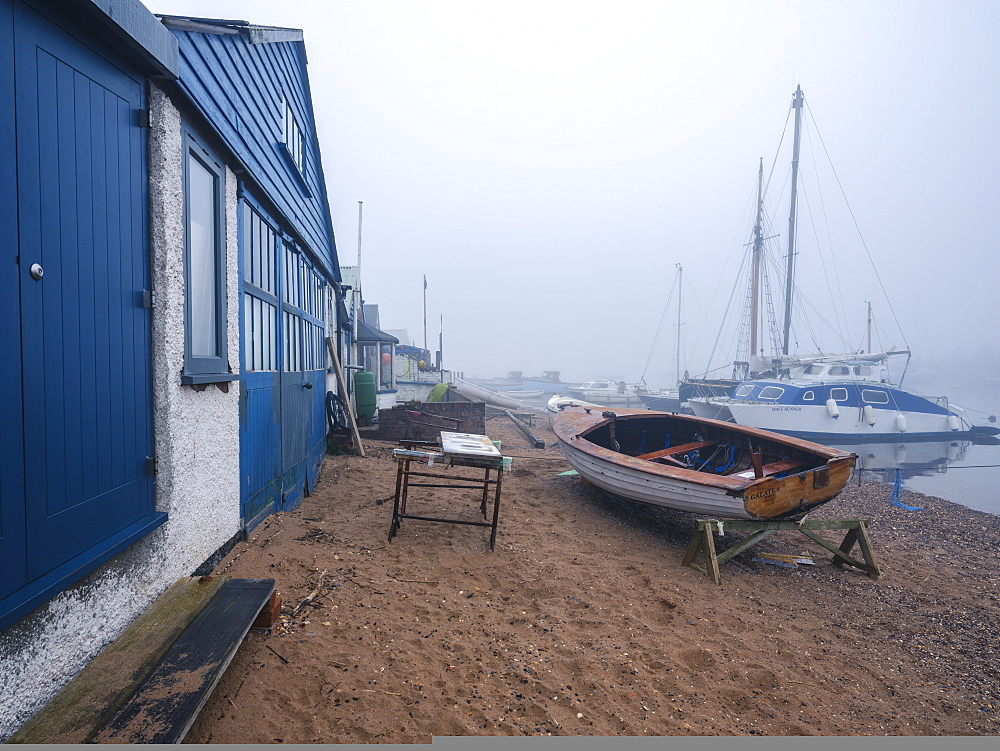 Misty scene with boats on the shoreline near the boatyard and sailmaker on a creek in Exmouth, Devon, England, United Kingdom, Europe - 1295-24