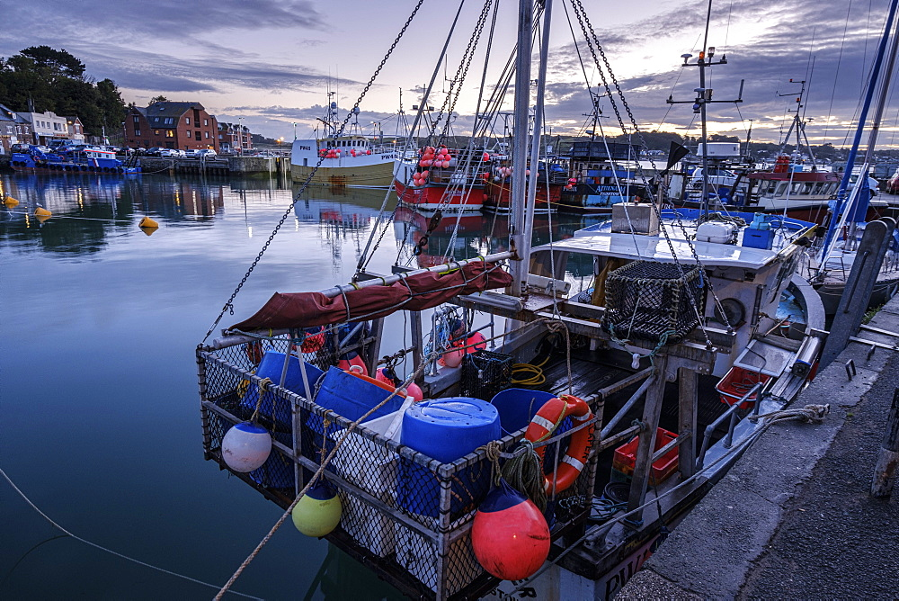 Boats in the harbour of the popular fishing port of Padstow, Cornwall, UK