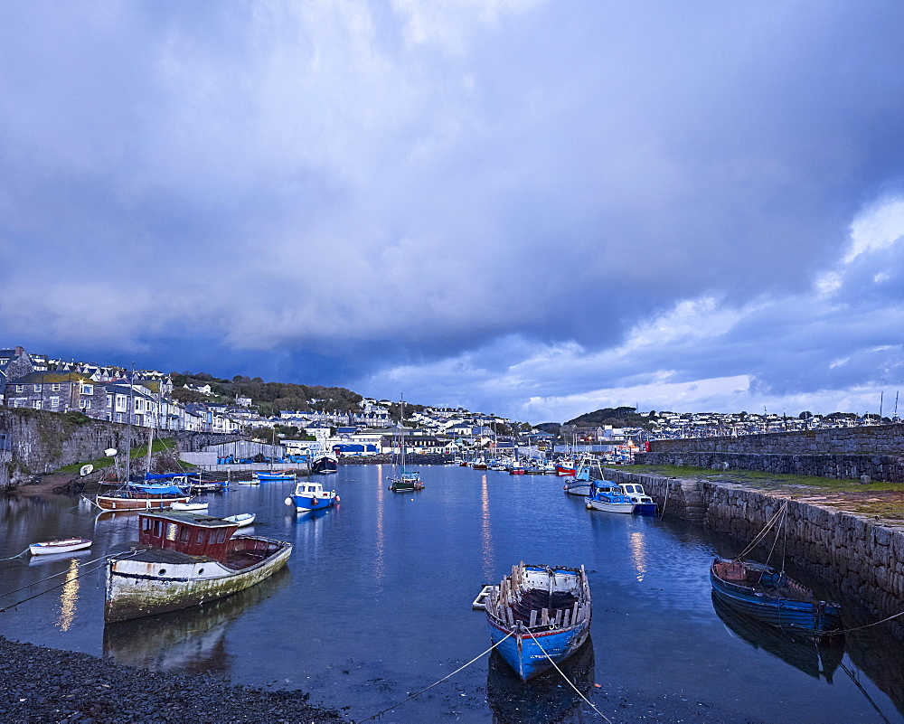 Moody clouds at the fishing port of Newlyn, Cornwall, UK