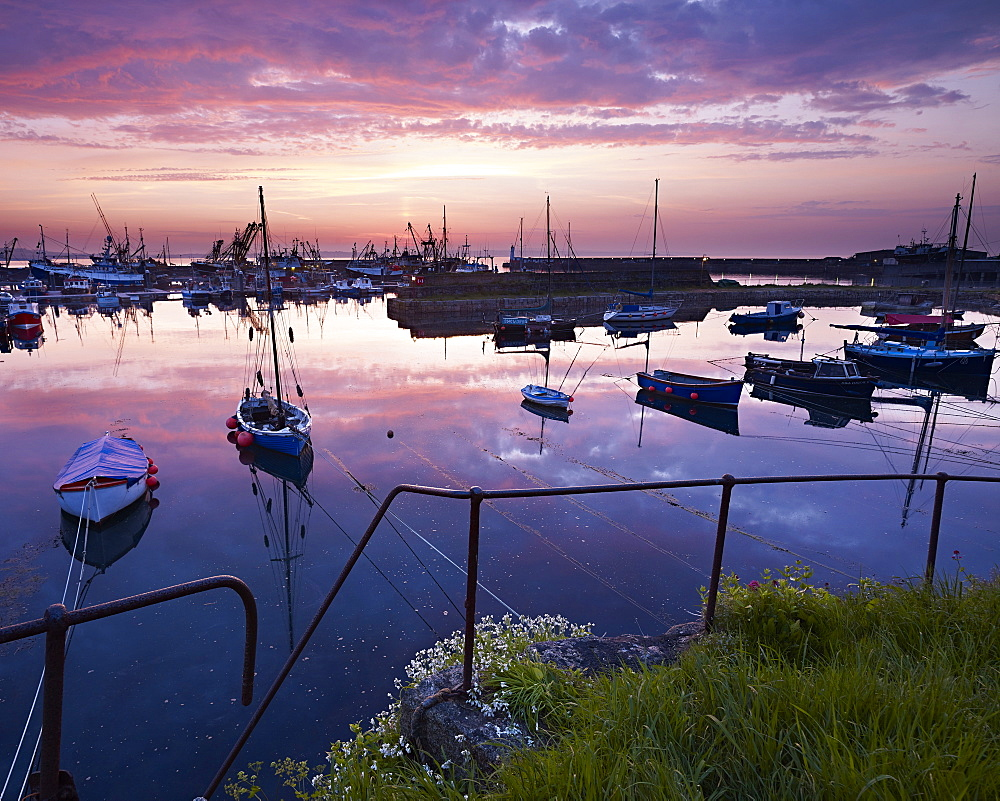 Spring twilight across the harbour of the fishing port of Newlyn, Cornwall, UK