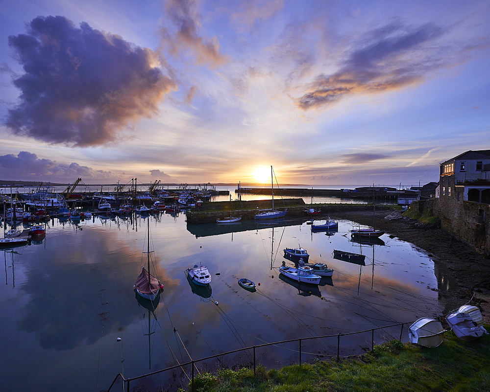 Spring sunrise across the harbour at the fishing port of Newlyn, Cornwall, UK