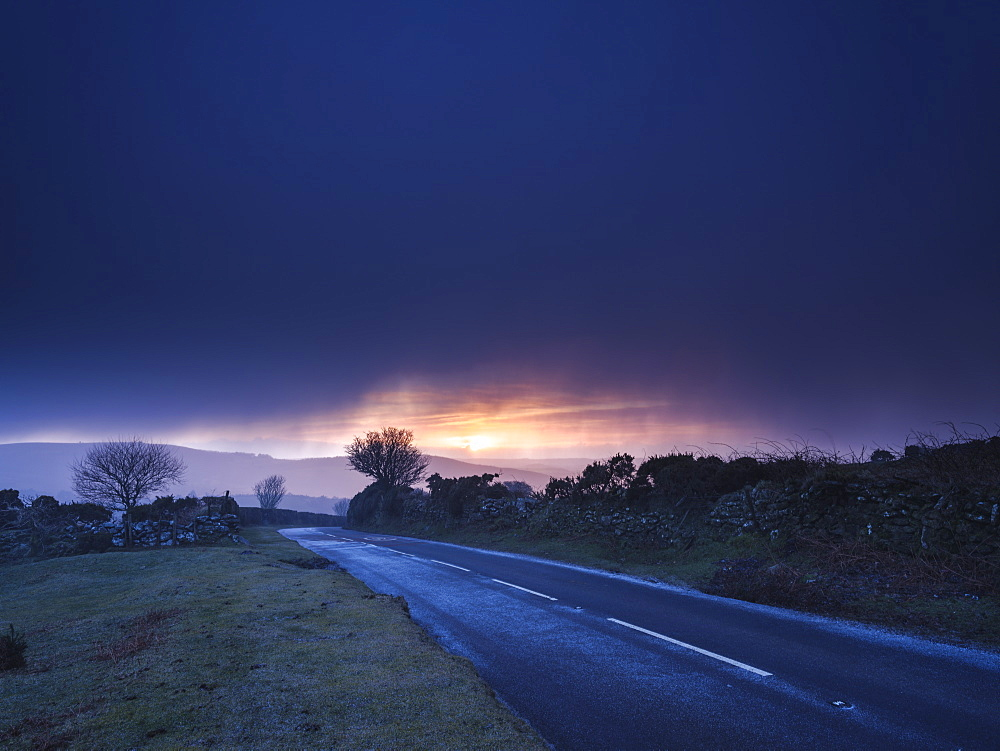 Moody winter sunrise in a hail shower at Bel Tor Corner, Dartmoor National Park, Ashburton, Devon, England, United Kingdom, Europe