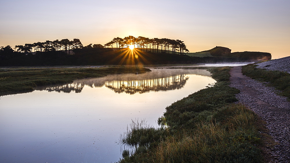 A scenic sunrise with mist and perfect reflections on the River Otter at Budleigh Salterton, Devon, England, United Kingdom, Europe - 1295-39