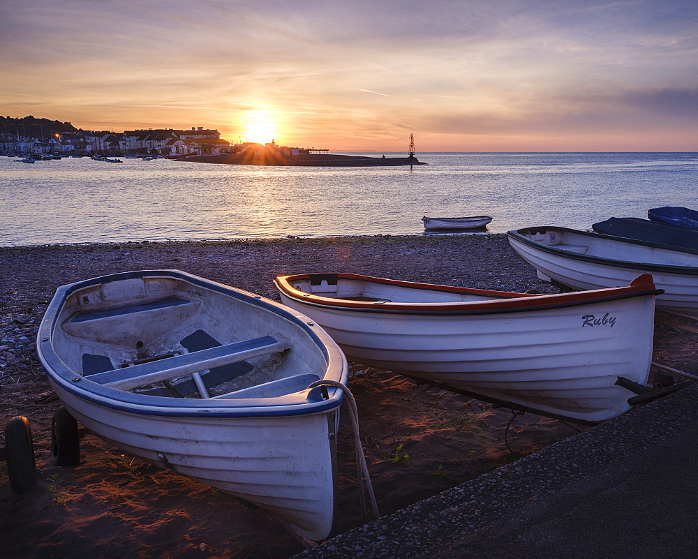 Boats at sunrise looking across entrance to Teign estuary to Teignmouth at Shaldon, Devon, England, United Kingdom, Europe