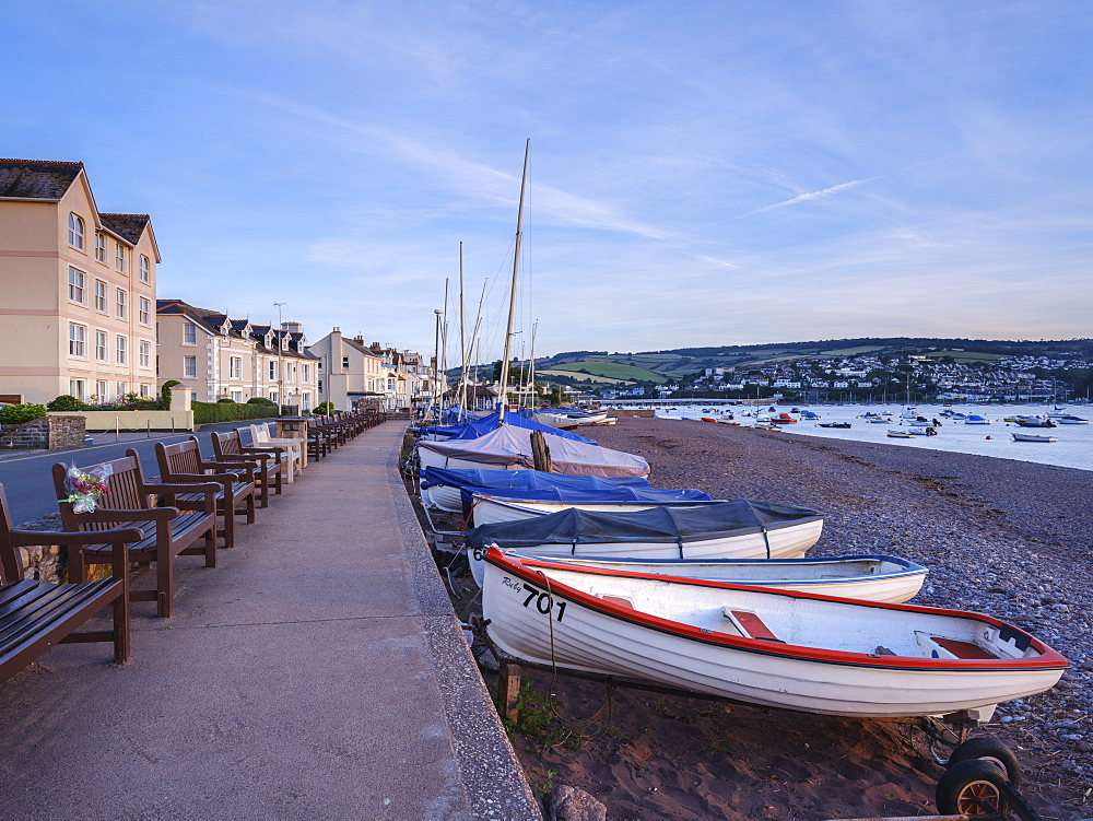 Boats and benches lined up along the top of the beach at Shaldon, Devon, England, United Kingdom, Europe