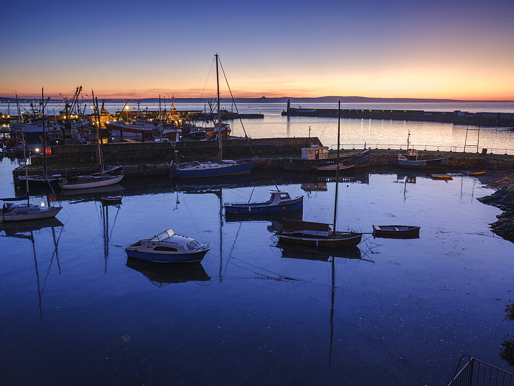 Sunrise looking across the inner and outer harbours at the fishing port of Newlyn, Cornwall, England, United Kingdom, Europe - 1295-86