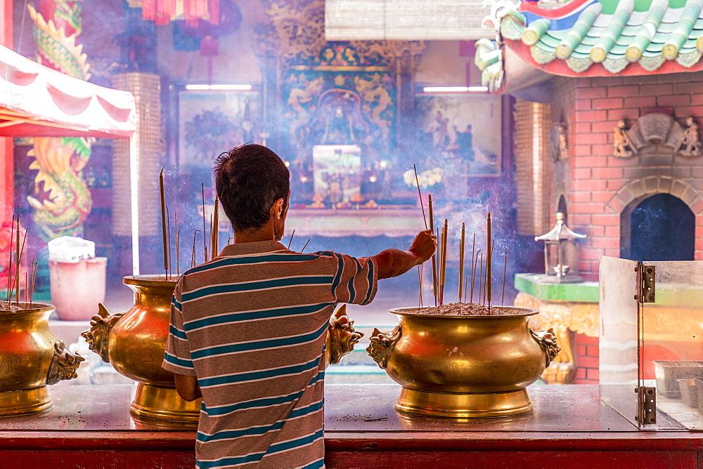 Praying in Guan Di Temple in Kuala Lumpur, Malaysia, Southeast Asia, Asia