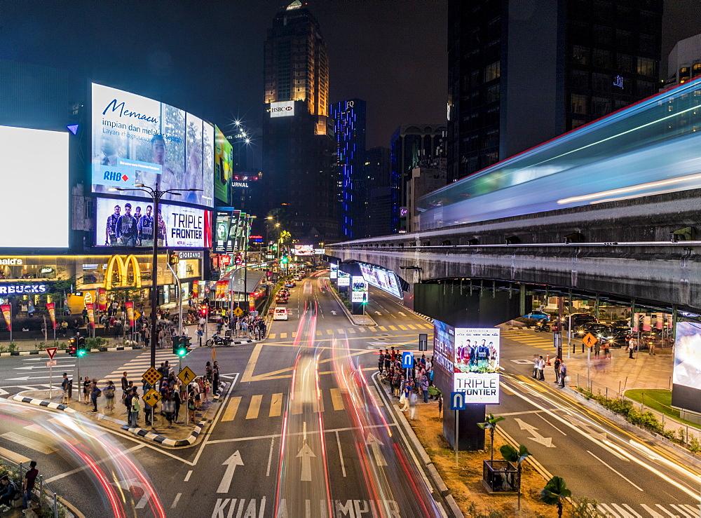Night street scene in Bukit Bintang with a passing KL Monorail in Kuala Lumpur, Malaysia, Southeast Asia, Asia - 1297-1076