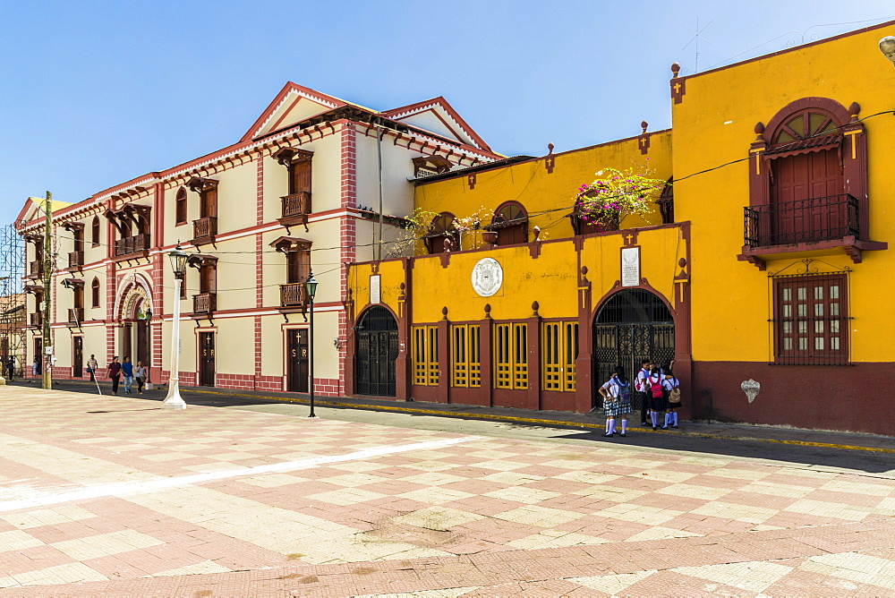 The colourful facade of the College of Ramon by Central Park in Leon, Nicaragua, Central America. - 1297-129