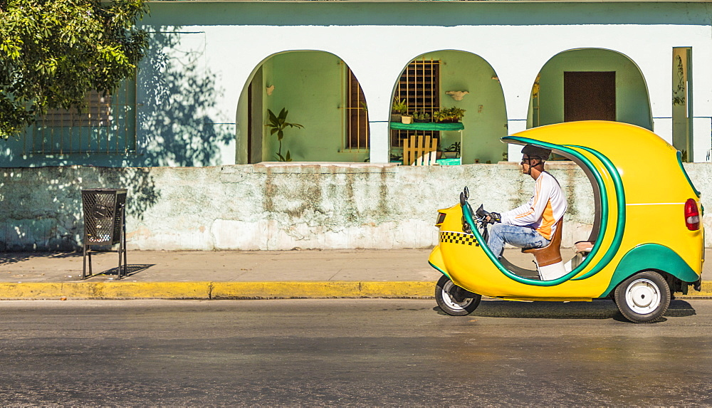A colourful local small taxi called a coco, in Varadero, Cuba, West Indies, Central America