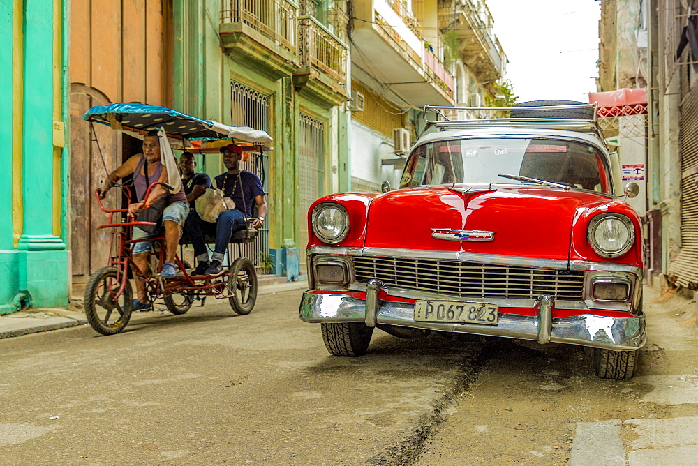 A vintage American car in a colourful street in Havana, Cuba, West Indies, Caribbean, Central America