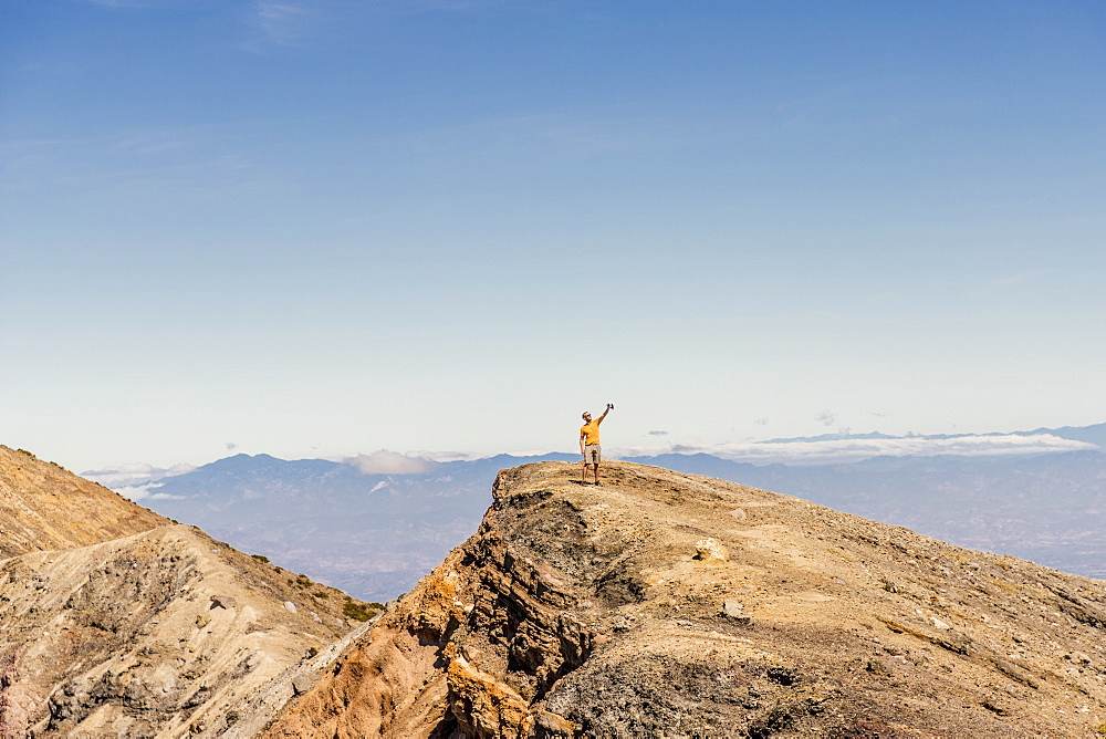 A tourist taking a selfie on top of the Santa Ana Volcano (Ilamatepec) in Santa Ana, El Salvador, Central America