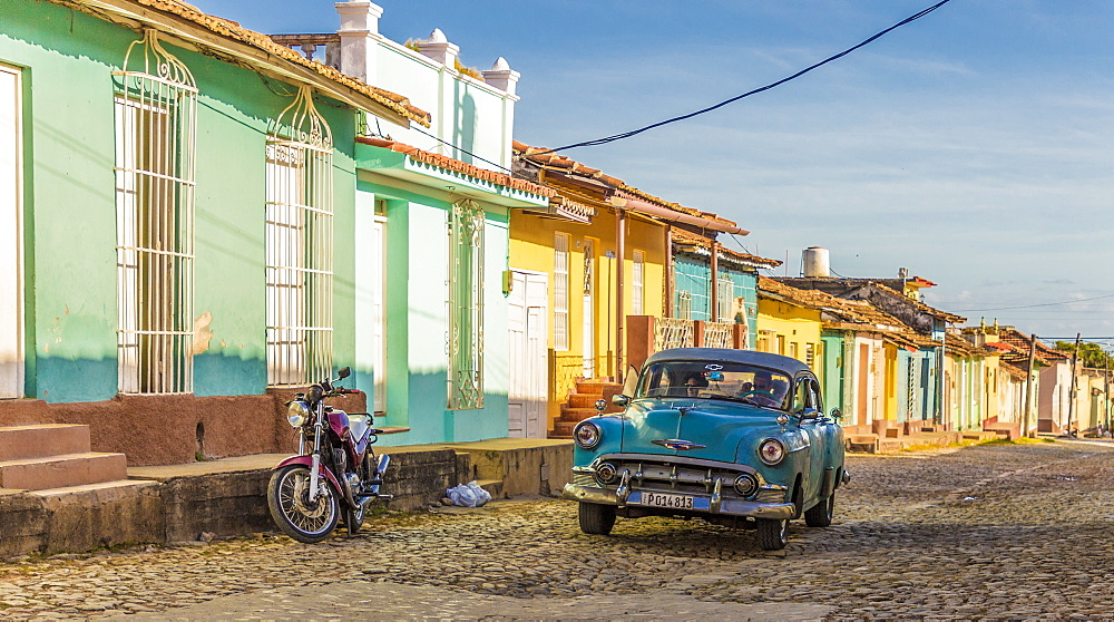 A classic car in a colourful colonial street in Trinidad, Cuba, Caribbean, Central America.