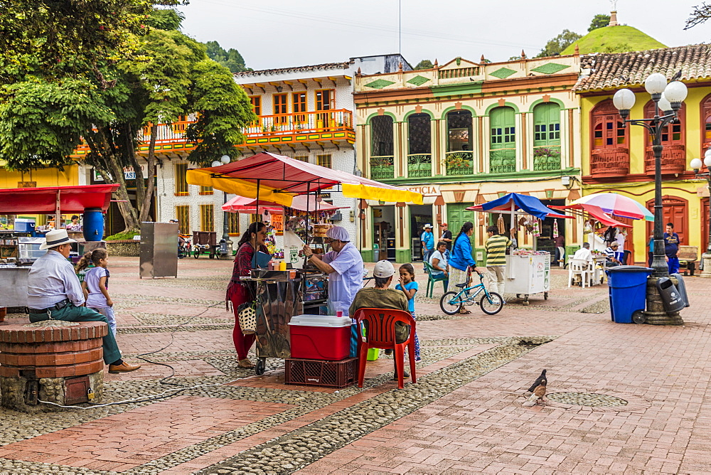 Colourful colonial architecture in the main square, Parque Reyes, in Jerico, Antioquia Colombia, South America.