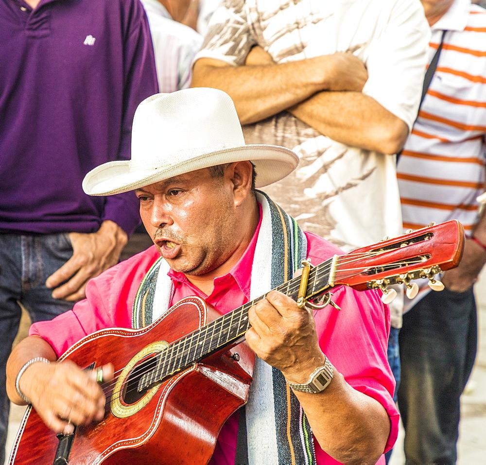 A local musician in Medellin, Colombia, South America