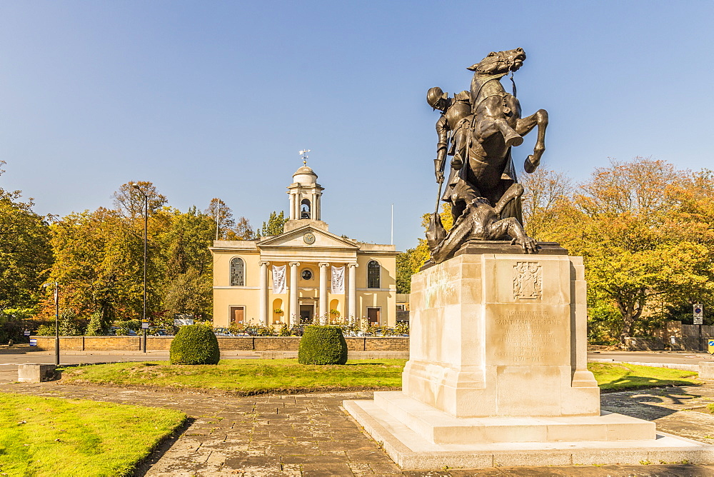 St. George and the Dragon statue and St. Johns Wood church in the background, London, England, United Kingdom, Europe