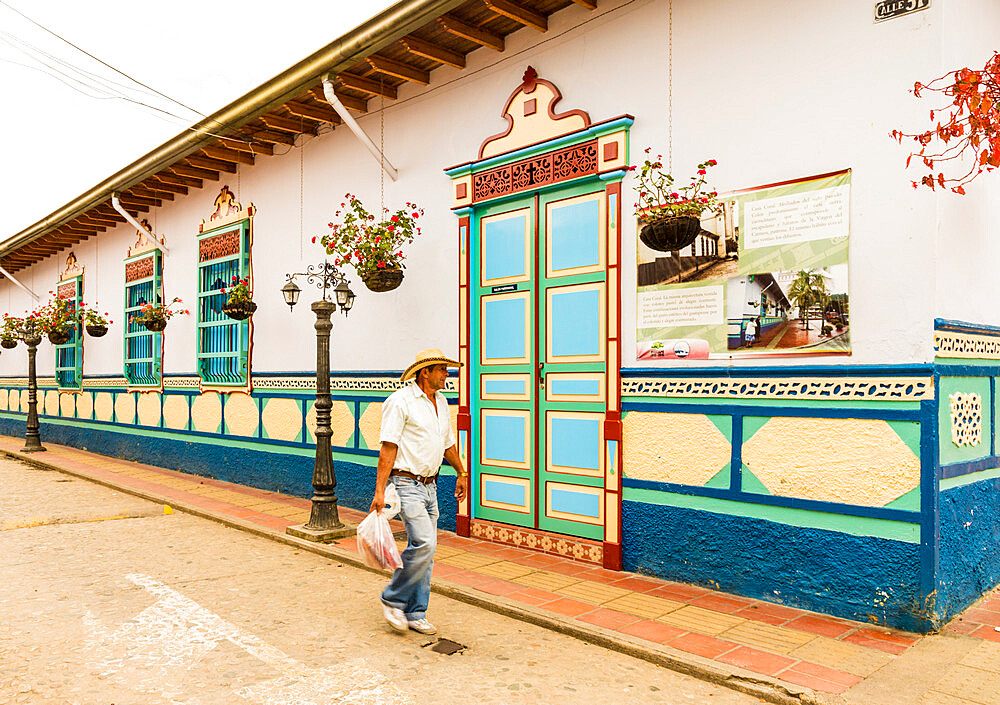 A typically colourful street with buildings covered in traditional local tiles in the picturesque town of Guatape in Colombia.
