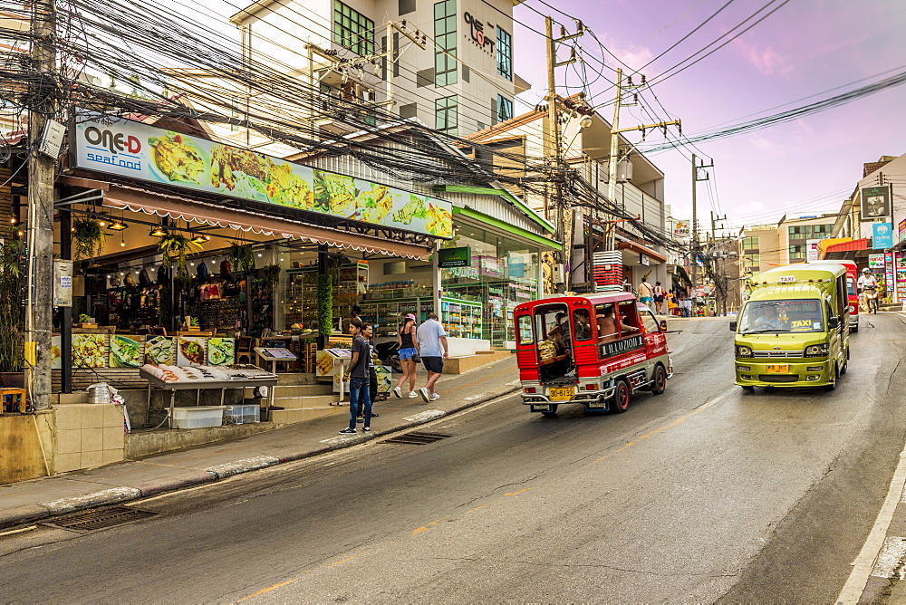 A street scene and local taxis and tuk tuks in Kata, Phuket, Thailand, Southeast Asia, Asia