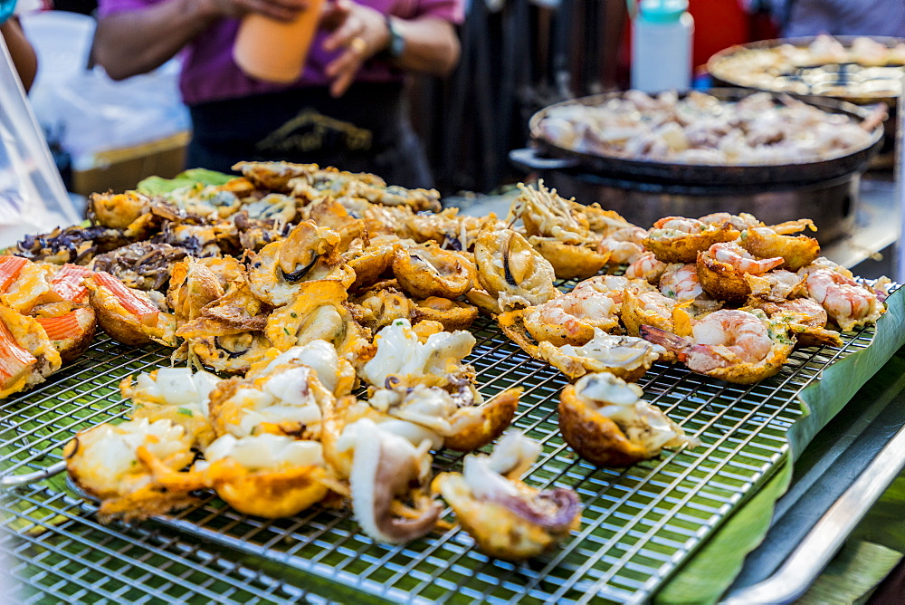 A fried seafood stall at the famous Walking Street night market in Phuket old Town, Phuket, Thailand, Southeast Asia, Asia