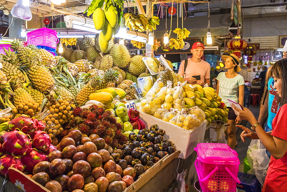 A fruit stall at the indoor Banzaan food market in Patong, Phuket, Thailand, Southeast Asia, Asia.