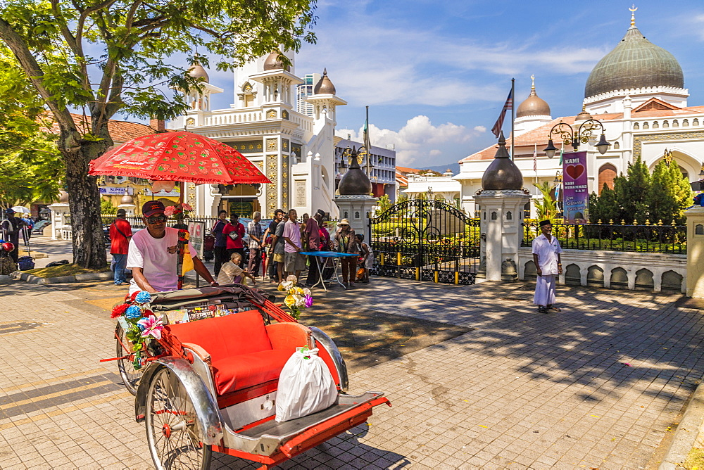 A local rickshaw (tuk tuk) outside Kapitan Keling Mosque, in George Town, Penang Island, Malaysia, Southeast Asia, Asia