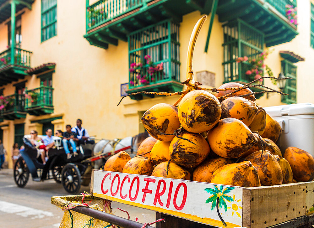 A street stall selling coconuts in the old town in Cartagena de Indias, Colombia, South America.