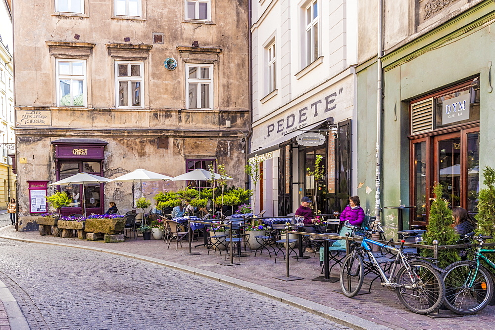 A cafe scene in the medieval old town, UNESCO World Heritage Site, in Krakow, Poland, Europe