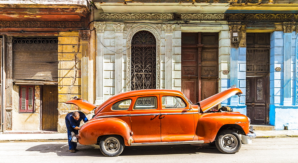 A typical street scene in Centro in Havana, Cuba, West Indies, Caribbean, Central America